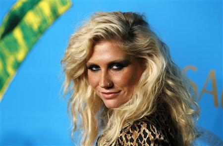 Singer Ke$ha arrives at a party to celebrate the upcoming launch of the Versace for H&M collection in New York November 8, 2011. REUTERS/Lucas Jackson/Files