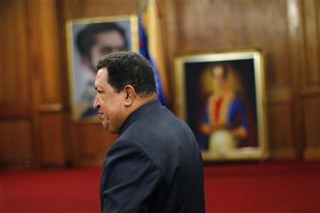 Venezuelan President Hugo Chavez leaves a news conference after winning elections in Caracas October 9, 2012. REUTERS/Jorge Silva