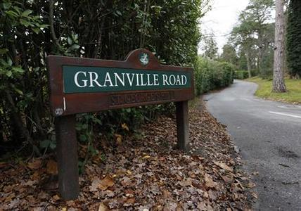 Granville Road on the St George's Hill private estate, where Russian businessman Alexander Perepilichnyy collapsed on November 10, is seen near Weybridge in Surrey November 28, 2012. A Russian businessman helping Swiss prosecutors uncover a powerful fraud syndicate has died in mysterious circumstances outside his mansion in Britain, in a chilling twist to a Russian mafia scandal that has strained Moscow's ties with the West. REUTERS/Olivia Harris