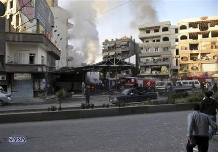 A crowd gathers at the site of a blast in Jaramana district, near Damascus, in this handout photograph released by Syria's national news agency SANA November 28, 2012. At least 34 people were killed in explosions which struck the eastern Damascus district of Jaramana on Wednesday, state television said, quoting a source at the Interior Ministry. It said 10 bags containing the remains of unidentified victims had also been collected. Eighty-three people were seriously wounded, it said. REUTERS/Sana