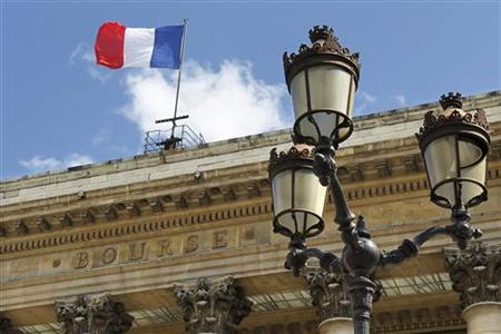 A flag flies from the roof of France's former Bourse or stock market building Paris August 18, 2010. REUTERS/Charles Platiau/Files