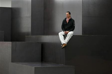 British artist Antony Gormley poses for a photograph on his sculpture 'Model' at a White Cube gallery in London November 27, 2012. REUTERS/Stefan Wermuth