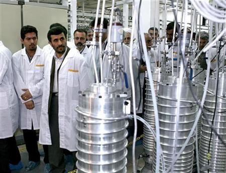 Iranian President Mahmoud Ahmadinejad (2nd L) visits the Natanz nuclear enrichment facility, 350 km (217 miles) south of Tehran, April 8, 2008. REUTERS/Presidential official website/Handout/Files