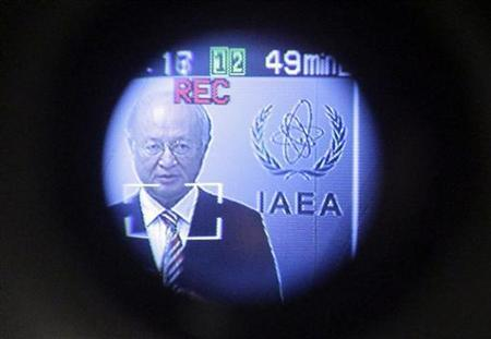 International Atomic Energy Agency (IAEA) Director General Yukiya Amano is seen through a video camera viewfinder as he attends a news conference during a board of governors meeting at the United Nations headquarters in Vienna September 10, 2012. REUTERS/Herwig Prammer/Files