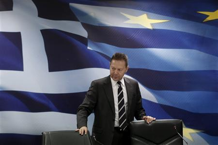 Greece's Finance minister Yannis Stournaras takes his seat for a news conference in Athens November 28, 2012. REUTERS/Yorgos Karahalis