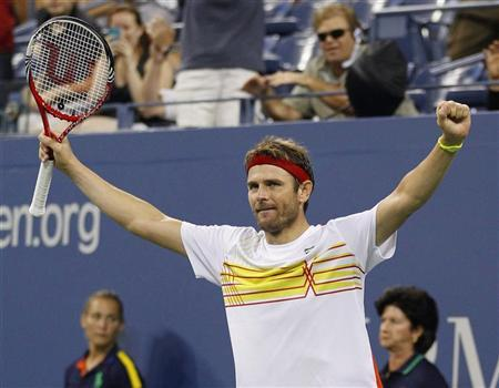 Mardy Fish of the U.S. celebrates defeating Gilles Simon of France during their match at the US Open men's singles tennis tournament in New York, September 1, 2012. REUTERS/Adam Hunger