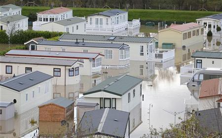 Holiday caravans lie in floodwater in St Asaph, north Wales, November 28, 2012. Dozens of properties were flooded in St Asaph after the River Elwy burst its banks yesterday. REUTERS/Andrew Winning