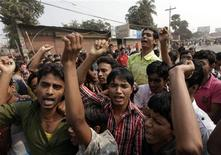 Garment workers chant slogans during a protest against the death of their colleagues in a devastating fire, in Savar November 28, 2012. Three supervisors of a Bangladeshi garments factory were arrested on Wednesday as protests over a fire that killed more than 100 people raged on into a third day, with textile workers and police clashing in the streets of a Dhaka suburb. REUTERS/Andrew Biraj