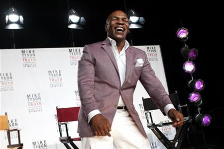 Former heavyweight champion Mike Tyson laughs as he talks in New York, June 18, 2012. REUTERS/Keith Bedford/Files