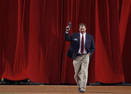 Former Boston Red Sox pitcher Roger Clemens is introduced as a member of the ''All-Time Fenway Park Team'' before the start of American League MLB baseball action between the Boston Red Sox and Tampa Bay Rays at Fenway Park in Boston, Massachusetts September 26, 2012. REUTERS/Jessica Rinaldi
