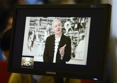 WikiLeaks founder Julian Assange, speaking during a teleconference from Ecuador's embassy in central London, is pictured on a screen during a news conference in Brussels November 27, 2012. REUTERS/Eric Vidal