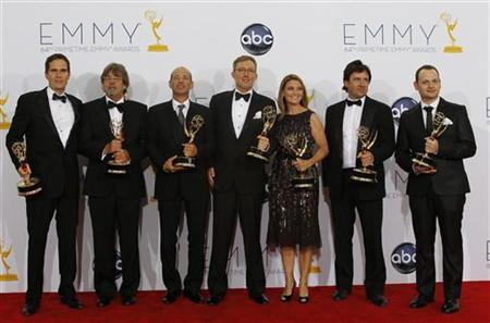 Alex Gansa (C) and fellow writers pose with their award for outstanding writing for a drama series for ''Homeland,'' backstage at the 64th Primetime Emmy Awards in Los Angeles, September 23, 2012. REUTERS/Mario Anzuoni/Files