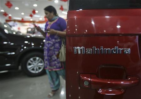 A customer walks inside a Mahindra cars showroom in the northern Indian city of Chandigarh November 26, 2012. REUTERS/Ajay Verma