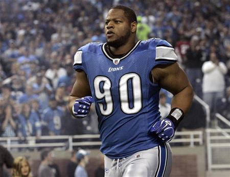 Detroit Lions defensive tackle Ndamukong Suh enters the field for the start of their NFL football game against the San Francisco 49ers in Detroit, Michigan, October 16, 2011. REUTERS/Rebecca Cook