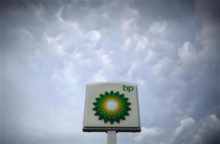 Storm clouds form near a BP station in Alexandria, Virginia July 19, 2010. REUTERS/Molly Riley