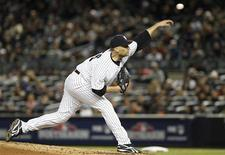 New York Yankees starter Andy Pettitte pitches to the Detroit Tigers during the second inning in Game 1 of their MLB ALCS playoff baseball series in New York, October 13, 2012. REUTERS/Adam Hunger