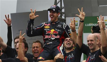 Red Bull Formula One driver Sebastian Vettel of Germany (C) celebrates winning the world championship with Team Principal Chrisian Horner (L) and Technical Chief Adrian Newey (R) after the Brazilian F1 Grand Prix at Interlagos circuit in Sao Paulo November 25, 2012. REUTERS/Nacho Doce