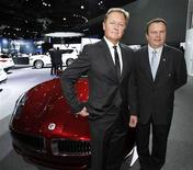 Henrik Fisker, (L), Executive Chairman and Co-Founder of Fisker Automotive and CEO Tony Posawatz pose with a Fisker Karma at the 2012 Los Angeles Auto Show in Los Angeles, California November 28, 2012. REUTERS/Mario Anzuoni