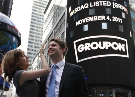 Groupon Chief Executive Andrew Mason poses with his newly married wife, pop musician Jenny Gillespie, outside the Nasdaq Market following his company's IPO in New York November 4, 2011. REUTERS/Brendan McDermid
