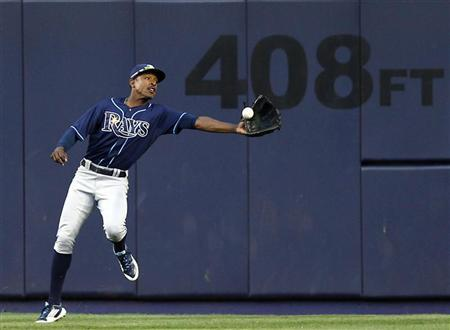 Tampa Bay Rays center fielder B.J. Upton fails to make a catch on an RBI single by New York Yankees Alex Rodriguez during the eighth inning of their MLB American League baseball game at Yankee Stadium in New York, September 15, 2012. REUTERS/Adam Hunger