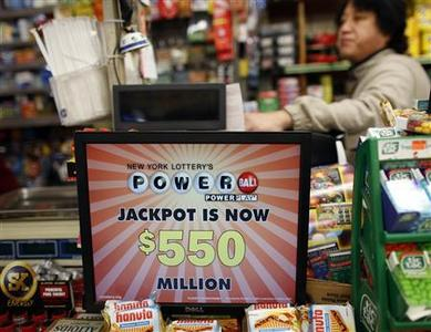 A shopkeeper waits for customers to buy tickets for the Powerball lottery in New York, November 28, 2012. Dreams of vast riches from a record Powerball lottery jackpot of more than half-a-billion dollars prompted a frenzy of ticket-buying across the United States ahead of Wednesday's draw, and continued heavy sales were nudging the payout even higher. REUTERS/Chip East