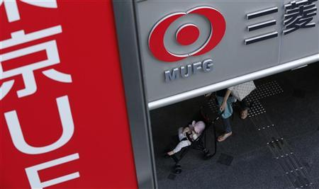 A baby on a stroller passes a branch of Mitsubishi UFJ Financial Group (MUFG) in Tokyo November 14, 2012. REUTERS/Yuriko Nakao