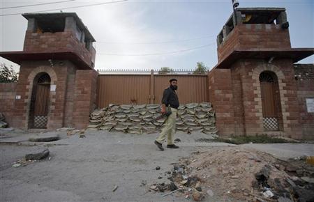 A police officer walks past Central Jail in Peshawar June 21, 2012. REUTERS/Fayaz Aziz
