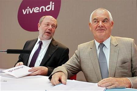 Jean-Francois Dubos (R), Chairman of the Management Board and CEO of Vivendi, and Philippe Capron, Chief Financial Officer of Vivendi, attend a news conference to present the Vivendi's half-year results in Paris August 30, 2012. REUTERS/Mal Langsdon