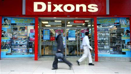 Pedestrians walk past a Dixons electrical retail shop in London April 28, 2004.  REUTERS/Stringer