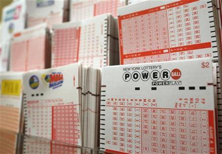 Cards for lottery customers to pick their own numbers are stacked on a rack at a store where people buy tickets for the Powerball lottery in New York, November 28, 2012. REUTERS/Chip East