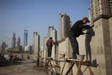 Workers build walls at a construction site at Pudong Lujiazui financial area in Shanghai November 12, 2012. REUTERS/Aly Song