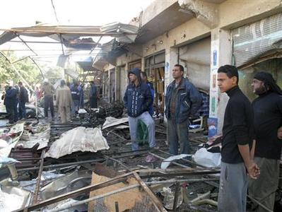Residents inspect the site of a bomb attack in Hilla, 100 km (60 miles) south of Baghdad, November 29, 2012. REUTERS/Habib