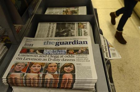 Newspapers are seen on sale at Victoria Station in central London November 29, 2012. Prime Minister David Cameron faces a no-win dilemma on Thursday when a far-reaching inquiry into British newspapers delivers its verdict on how to curb the excesses of the country's notoriously aggressive press.REUTERS/Paul Hackett