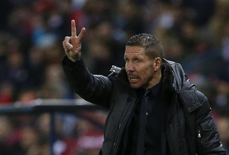 Atletico Madrid's coach Diego Simeone gestures during their Spanish first division soccer match against Getafe at the Vicente Calderon stadium in Madrid, November 11, 2012. REUTERS/Juan Medina