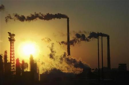 Smoke billows from chimneys at a chemical factory in Tianjin Municipality December 23, 2008. REUTERS/Stringer/Files