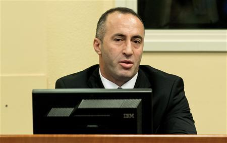 Kosovo's former Prime Minister and former commander of the Kosovo Liberation Army Ramush Haradinaj attends the judgement in his retrial at the International Criminal Tribunal for the former Yugoslavia in The Hague November 29, 2012. REUTERS/Koen van Weel/Pool