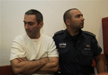 Aleksandar Cvetkovic (L), a Bosnian Serb who moved to Israel in 2006, attends a hearing at Jerusalem District Court July 10, 2011. REUTERS/Ronen Zvulun