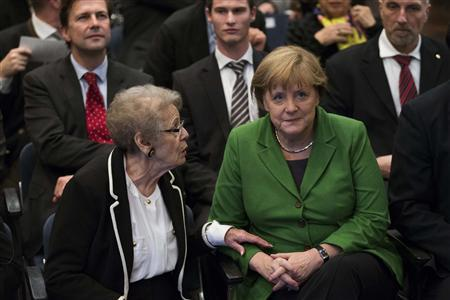 Ruth Galinski (L), the widow of the former president of the Central Council of Jews in Germany chairman Heinz Galinski, talks with German Chancellor Angela Merkel before Merkel received the Galinski Award at a Jewish community centre in Berlin November 28, 2012. REUTERS/Thomas Peter