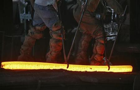 Labourers work inside an iron factory on the outskirts of Jammu November 12, 2012. REUTERS/Mukesh Gupta