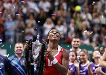 Serena Williams of the U.S. celebrates with the trophy after her victory against Russia's Maria Sharapova after their final WTA tennis championships match in Istanbul, October 28, 2012. REUTERS/Osman Orsal