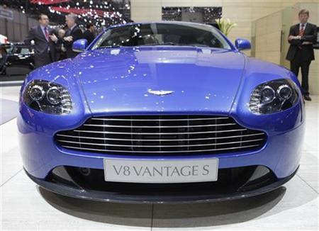 A new Aston Martin V8 Vantage S car is displayed during the first media day of the 81st Geneva International Motor Show at the Palexpo in Geneva March 1, 2011. REUTERS/Denis Balibouse/Files