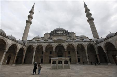 Visitors walk at the courtyard of the Ottoman-era Suleymaniye Mosque in Istanbul November 28, 2012. Tayyip Erdogan has described his third term as Turkish prime minister as that of a ''master'', borrowing from the celebrated Ottoman architect Sinan and the last stage of his storied career after apprenticeship and graduation. Now, entering a second decade at the helm of a country revelling in its regional might, Erdogan wants to leave his own mark on the cityscape with what will be Turkey's biggest mosque, a ''giant mosque,'' he says, ''that will be visible from all across Istanbul.'' But the Istanbul elite are up in arms and some have branded the proposed mosque unsightly and ostentatious. Picture taken November 28, 2012. REUTERS/Murad Sezer