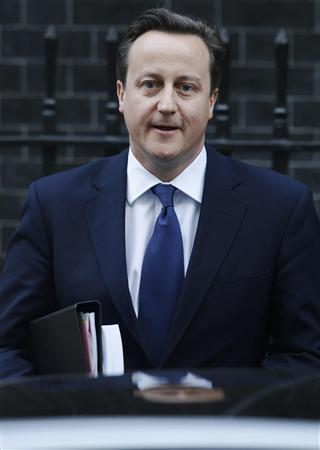 Britain's Prime Minister David Cameron leaves Downing Street in London November 29, 2012. A far-reaching inquiry into British newspapers called for a new independent watchdog enshrined in law to regulate the press, to prevent a repeat of the excesses which led to a phone hacking scandal at Rupert Murdoch's News of the World tabloid. REUTERS/Luke MacGregor