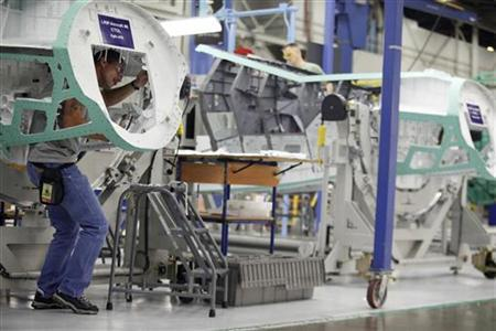 An assembly line worker works on Lockheed Martin's production plant for the F-35 fighter aircraft in Fort Worth, Texas August 31, 2009. REUTERS/Jessica Rinaldi
