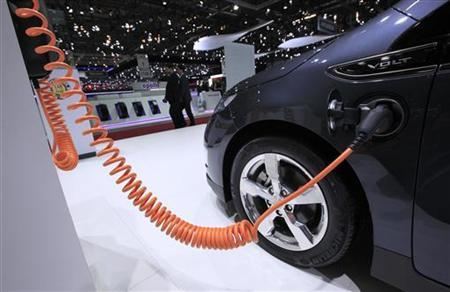 A plug is pictured on the Chevrolet Volt electric car during the second media day of the 82nd Geneva Car Show at the Palexpo Arena in Geneva March 7, 2012. REUTERS/Denis Balibouse/Files