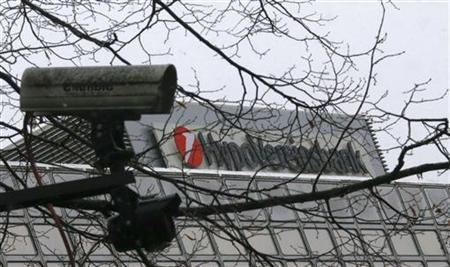 A CCTV camera is pictured next to the logo of UniCredit SpA's German unit HVB (Hypovereinsbank) in Munich November 29, 2012. State prosecutors raided the Munich offices of UniCredit SpA's German unit HVB as part of a tax evasion probe relating to share deals several years ago, HVB said on Thursday. REUTERS/Michael Dalder(GERMANY - Tags: BUSINESS SPORT BASKETBALL)