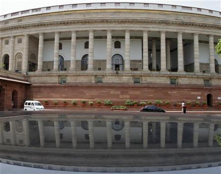 A view of the parliament is reflected on a car in New Delhi April 24, 2012. REUTERS/B Mathur/Files