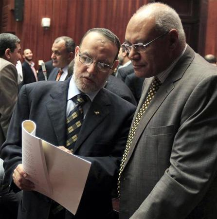 Essam El-Erian (L), who is in charge of the Political Bureau of the Muslim Brotherhood members of Egypt's constitution committee, speaks with former presidential candidate Mohammad Salim Al-Awa at the Shura Council during the final vote on the new draft constitution in Cairo November 29, 2012. An assembly drafting Egypt's new constitution voted on Thursday to keep the principles of Islamic law as the main source of legislation, unchanged from the previous constitution in force under former President Hosni Mubarak. REUTERS/Mohamed Abd El Ghany (EGYPT - Tags: POLITICS RELIGION)