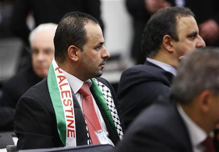 Members of the Palestinian delegation listen during the Special Meeting of the Committee on the Exercise of the Inalienable Rights of the Palestinian People, in observance of the International Day of Solidarity with the Palestinian People, at the U.N. headquarters in New York, November 29, 2012. REUTERS/Chip East