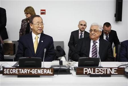 Palestinian President Mahmoud Abbas (R) and United Nations Secretary-General Ban Ki-moon, sit before the Special Meeting of the Committee on the Exercise of the Inalienable Rights of the Palestinian People, in observance of the International Day of Solidarity with the Palestinian People, at the U.N. headquarters in New York, November 29, 2012. REUTERS/Chip East (UNITED STATES - Tags: POLITICS TPX IMAGES OF THE DAY)